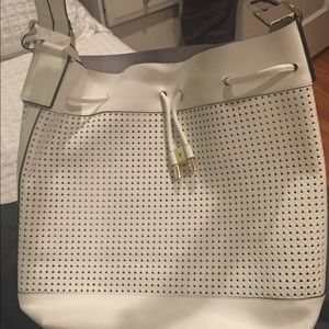 Large white leather hobo bag. Perforated leather
